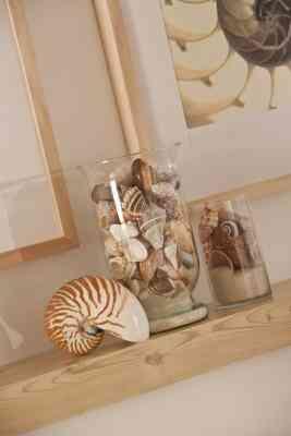 Wie Machen Muscheln und Sand in ein Glas